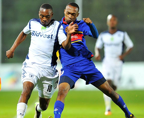 Sibusiso Vilakazi of Bidvest Wits challenged by Thabo Mosadi of University Pretoria during the Nedbank Cup match between Bidvest Wits and University of Pretoria at the Bidvest Stadium in Johannesburg, South Africa on March 17, 2015 ©Samuel Shivambu/BackpagePix