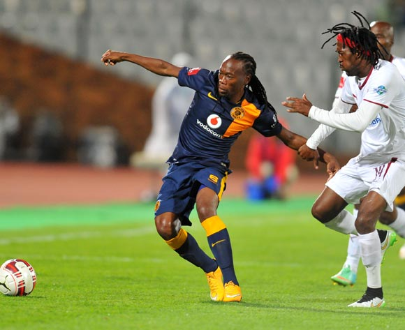 Reneilwe Letsholonyane of Kaizer Chiefs challenged by Lerato Chabangu of Moroka Swallows during the Absa Premiership match between Moroka Swallows and Kaizer Chiefs at the Dobsonville Stadium in Johannesburg, South Africa on March 18, 2015