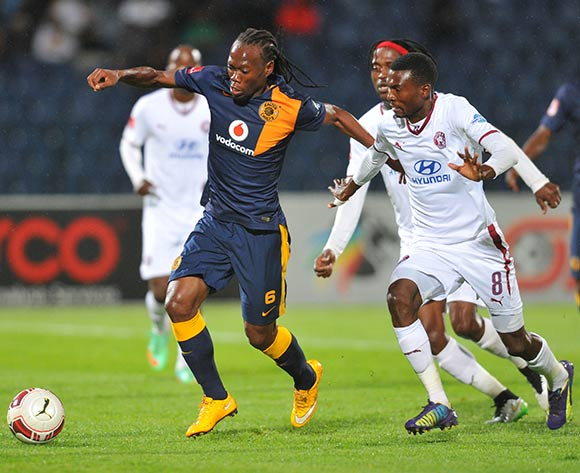 Reneilwe Letsholonyane of Kaizer Chiefs challenged by Lucky Baloyi of Moroka Swallows during the Absa Premiership match between Moroka Swallows and Kaizer Chiefs at the Dobsonville Stadium in Johannesburg, South Africa on March 18, 2015 ©Samuel Shivambu/BackpagePix