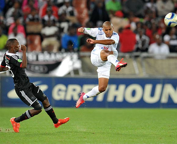 Ryan Chapman of Supersport United challenged by Thabo Rakhale of Orlando Pirates during the Nedbank Cup match between Supersport United and Orlando Pirates at the Peter Mokaba Stadium in Polokwane, South Africa on March 21, 2015 ©Samuel Shivambu/BackpagePix