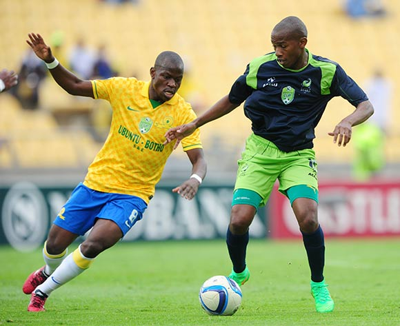 Sibusiso Msomi of Platinum Stars challenged by Hlompho Kekana of Mamelodi Sundowns during the 2015 Nedbank Cup match between Platinum Stars and Mamelodi Sundowns at the Royal Bafokeng Stadium, Rustenburg on the 22 March 2015  ©Muzi Ntombela/BackpagePix