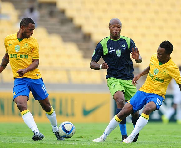 Letladi Madubanya of Platinum Stars challenged by Teko Modise and Mzikayise Mashaba of Mamelodi Sundowns during the 2015 Nedbank Cup match between Platinum Stars and Mamelodi Sundowns at the Royal Bafokeng Stadium, Rustenburg on the 22 March 2015  ©Muzi Ntombela/BackpagePix