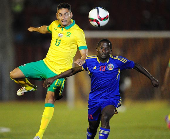 Alexander Cole of South Africa challenged by Xolane Sibandze of Swaziland during the International Friendly match between Swaziland and South Africa at the Somhlolo Stadium, Lobamba on the 25 March 2015