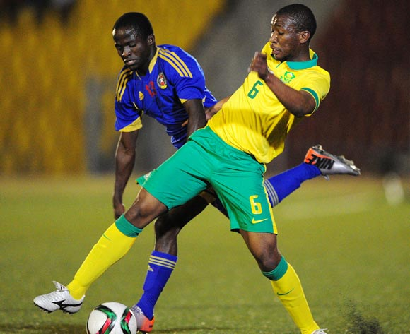 Xolane Sibandze of Swaziland battles with Kamohelo Mokotjo of South Africa during the International Friendly match between Swaziland and South Africa at the Somhlolo Stadium, Lobamba on the 25 March 2015