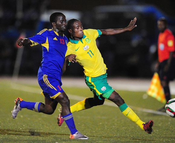Thabo Matlaba of South Africa challenged by Xolane Sibandze of Swaziland during the International Friendly match between Swaziland and South Africa at the Somhlolo Stadium, Lobamba on the 25 March 2015