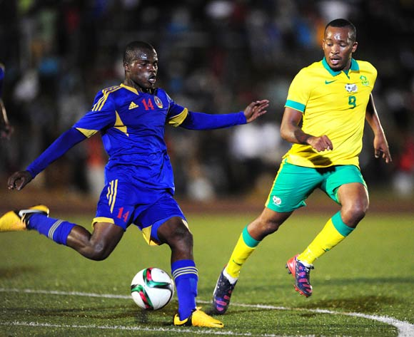 Machane Dlamini of Swaziland challenged by Lehlohonolo Majoro of South Africa during the International Friendly match between Swaziland and South Africa at the Somhlolo Stadium, Lobamba on the 25 March 2015