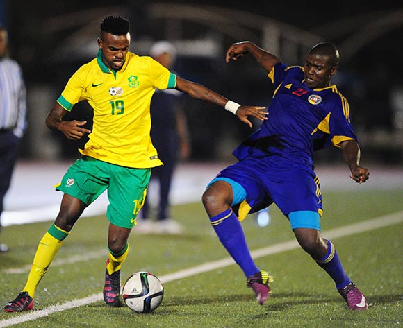 Jabulani Shongwe of South Africa tackled by Phinda Dlamini of Swaziland during the International Friendly match between Swaziland and South Africa at the Somhlolo Stadium, Lobamba on the 25 March 2015  ©Muzi Ntombela/BackpagePix