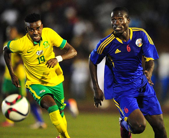 Sanele Mkhweli of Swaziland challenged by Jabulani Shongwe of South Africa during the International Friendly match between Swaziland and South Africa at the Somhlolo Stadium, Lobamba on the 25 March 2015  ©Muzi Ntombela/BackpagePix