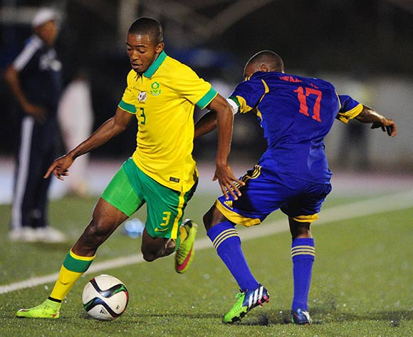 Thapelo Morena of South Africa challenged by Tony Tsabedze of Swaziland during the International Friendly match between Swaziland and South Africa at the Somhlolo Stadium, Lobamba on the 25 March 2015  ©Muzi Ntombela/BackpagePix