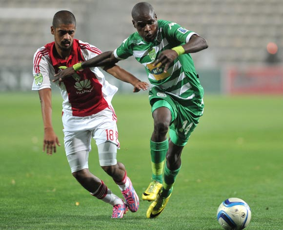 Abbubaker Mobara of Ajax Cape Town and Lerato Lamola of Bloemfontein Celtic during the Nedbank Cup match between Ajax Cape Town and Bloemfontein Celtic at the Athlone Stadium in Cape Town, South Africa on March 20, 2015