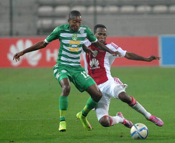 Thapelo Morena of Bloemfontein Celtic and Mosa Lebusa of Ajax Cape Town during the Nedbank Cup match between Ajax Cape Town and Bloemfontein Celtic at the Athlone Stadium in Cape Town, South Africa on March 20, 2015