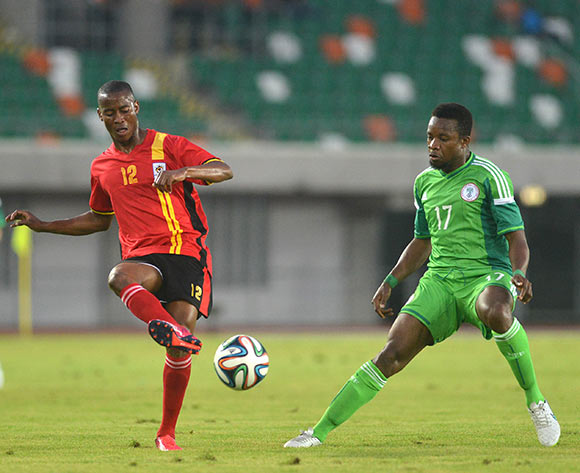Kakuba Alex of Uganda against Onazi Ogenyi of Nigeria during the International Friendly match between Nigeria v Uganda on march 25th, 2015 at Akwa Ibom Stadium © Kabiru Abubakar/Backpagepix