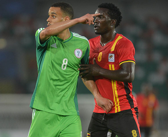 Ukoh (left) in action for Nigeria - He is ruled out of the match against Chad due to a knee injury