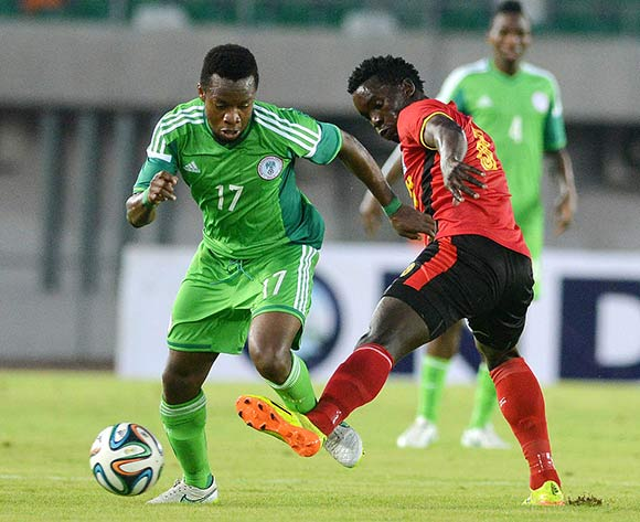 Eagles star Onazi (left) in recent action against Uganda