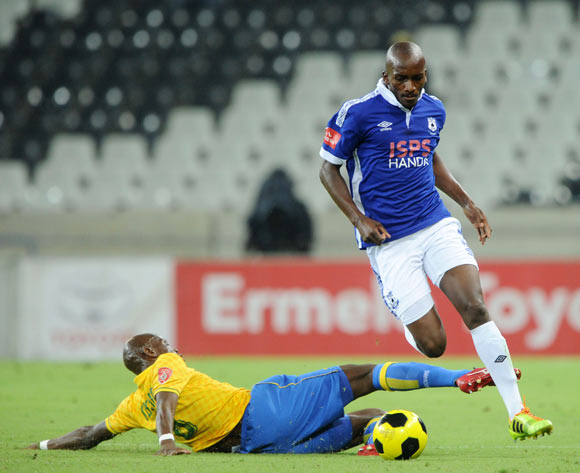 Lehlohonolo Nonyane of Black Aces tackled by Hlompho Kekana of Mamelodi Sundowns during the Absa Premiership 2014/15 match between  Black Aces and Mamelodi Sundowns at the Mbombela Stadium, Mbombela on the 08 April 2015