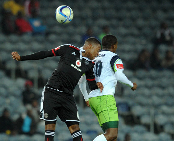 Happy Jele of Orlando Pirates battles with Ndumiso Mabena of Orlando Pirates during the Absa Premiership match between Orlando Pirates and Platinum Stars  on 08 April2015 at Orlando Stadium