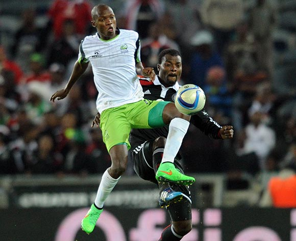 Rooi Mahamutsa of Orlando Pirates  battles with Mogakolodi Ngele of Platinum Stars during the Absa Premiership match between Orlando Pirates and Platinum Stars  on 08 April2015 at Orlando Stadium Pic Sydney Mahlangu/BackpagePix
