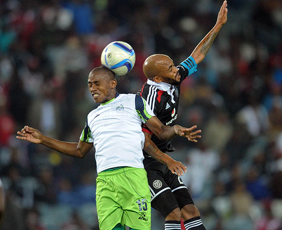 Oupa Manyisa of Orlando Pirates battles with Sibusiso Msomi of Platinum Stars   during the Absa Premiership match between Orlando Pirates and Platinum Stars  on 08 April2015 at Orlando Stadium Pic Sydney Mahlangu/BackpagePix