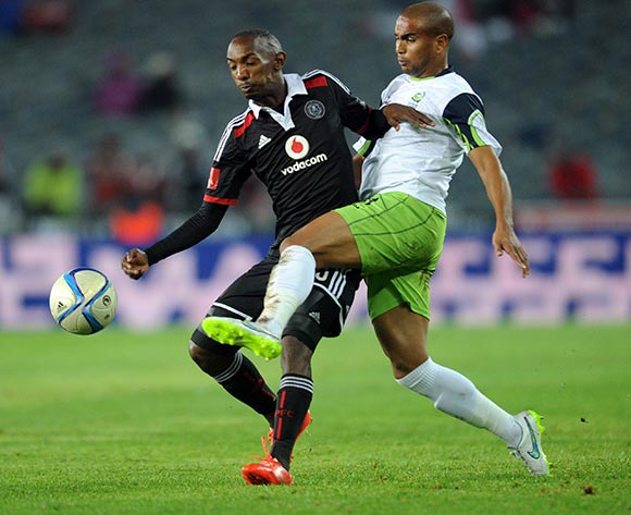 Thabo Rakhale of Orlando Pirates battles with Bryce Moon of Orlando Pirates during the Absa Premiership match between Orlando Pirates and Platinum Stars  on 08 April2015 at Orlando Stadium Pic Sydney Mahlangu/BackpagePix