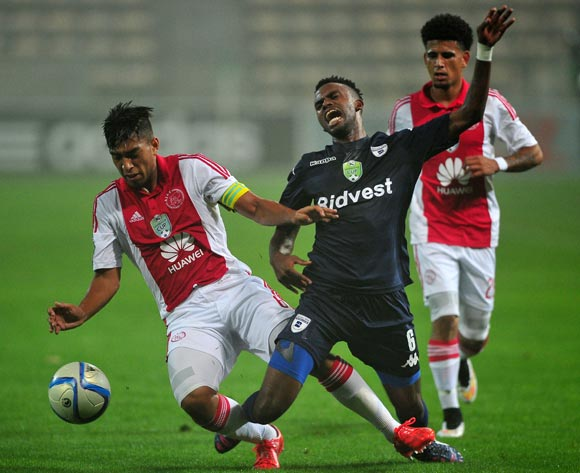 Travis Graham of Ajax Cape Town and Jabulani Shongwe of Bidvest Wits battle for possession during the 2015 Nedbank Cup quarter final between Ajax Cape Town and Bidvest Wits game at Athlone Stadium, Cape Town on 10 April 2015