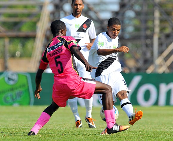 Samuel Julies of Vasco Da Gama challenged by Harry Nyirinda of Black Leopards during the 2015 Nedbank Cup quarter final match between Black Leopards and Vasco Da Gama at the Thohoyandou Stadium in Limpopo, South Africa on April 11, 2015 ©Samuel Shivambu/BackpagePix