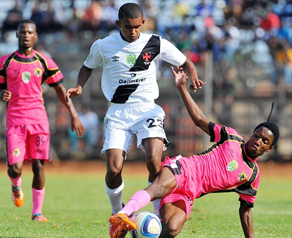 Abdul Jacobs of Vasco Da Gama tackled by Marks Munyai of Black Leopards during the 2015 Nedbank Cup quarter final match between Black Leopards and Vasco Da Gama at the Thohoyandou Stadium in Limpopo, South Africa on April 11, 2015 ©Samuel Shivambu/BackpagePix