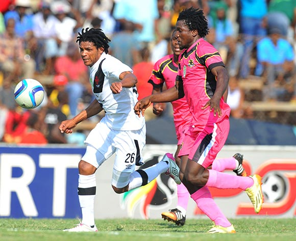 Aleni Lebyane of Vasco Da Gama challenged by Thivhavhudzi Ndou of Black Leopards during the 2015 Nedbank Cup quarter final match between Black Leopards and Vasco Da Gama at the Thohoyandou Stadium in Limpopo, South Africa on April 11, 2015 ©Samuel Shivambu/BackpagePix
