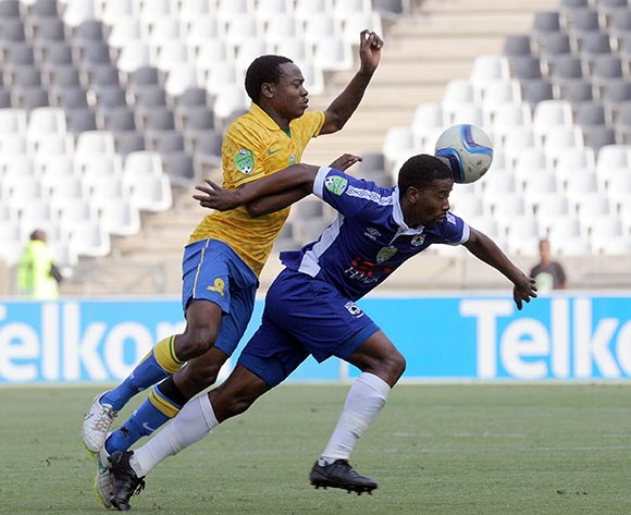 Abia Nale of Black Aces is held back by Percy Tau of Mamelodi Sundowns during the Nedbank Cup Match between Black Aces and Mamelodi Sundowns  on 12 April2015 at Mbombela Stadium Pic Sydney Mahlangu/BackpagePix