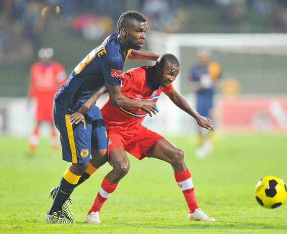 Thabo Mosadi of University Pretoria challenged by Tefu Mashamaite of Kaizer Chiefs during the Absa Premiership 2014/15 match between University of Pretoria and Kaizer Chiefs at the Tuks Stadium in Pretoria, South Africa on April 14, 2015