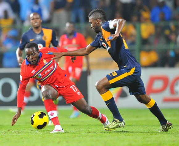Atusaye Nyondo of University of Pretoria challenged by Tefu Mashamaite of Kaizer Chiefs during the Absa Premiership 2014/15 match between University of Pretoria and Kaizer Chiefs at the Tuks Stadium in Pretoria, South Africa on April 14, 2015