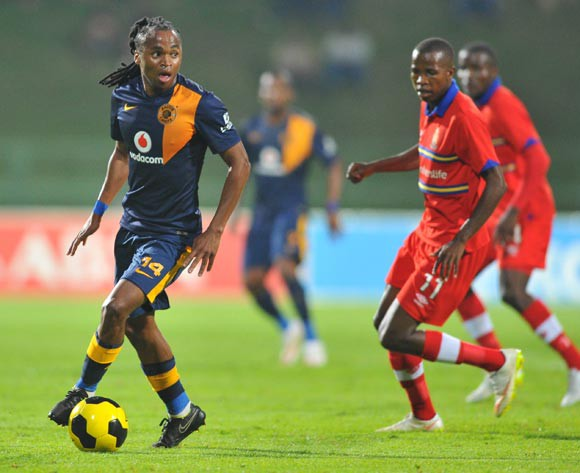 Siphiwe Tshabalala of Kaizer Chiefs challenged by Thabo Mosadi of University Pretoria during the Absa Premiership 2014/15 match between University of Pretoria and Kaizer Chiefs at the Tuks Stadium in Pretoria, South Africa on April 14, 2015