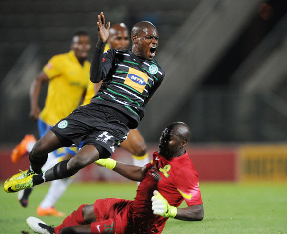 Lerato Lamola of Bloemfontein Celtic tackled by Dennis Onyango of Mamelodi Sundowns during the Absa Premiership 2014/15 match between Mamelodi Sundowns and Bloemfontein Celtic at the Lucas Moripe Stadium, Attridgeville on the 15 April 2015