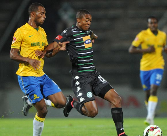 Thapelo Morena of Bloemfontein Celtic challenged by Mzikayise Mashaba of Mamelodi Sundowns during the Absa Premiership 2014/15 match between Mamelodi Sundowns and Bloemfontein Celtic at the Lucas Moripe Stadium, Attridgeville on the 15 April 2015