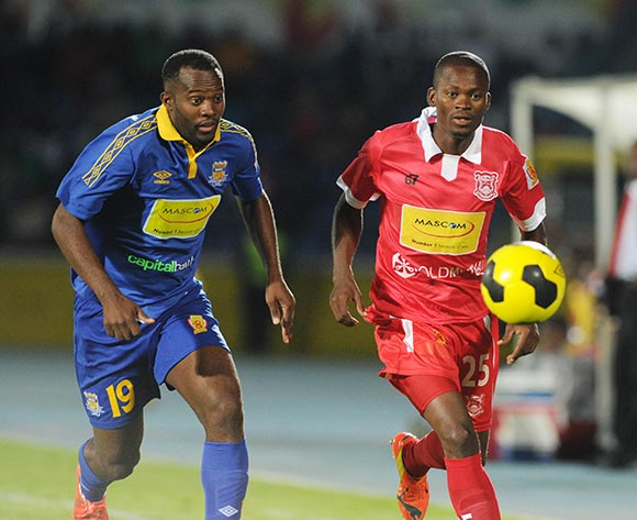 Oswego Gaotewe of Gaborone United challenged by Jerome Louis of Township Rollers during the 2015 Mascom Top 8 Final match between Township Rollers and Gaborone United at the National Stadium, Gaborone on the 18 April 2015  ©Muzi Ntombela/BackpagePix