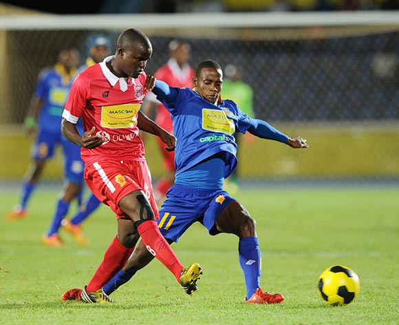Alphonse Modisaotsile of Gaborone United challenged by Segolame Boy of Township Rollers during the 2015 Mascom Top 8 Final match between Township Rollers and Gaborone United at the National Stadium, Gaborone on the 18 April 2015  ©Muzi Ntombela/BackpagePix