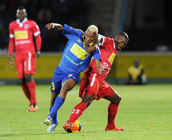 Kebaikanye Kobamelo of Township Rollers battles with Gaotewe Osego of Gaborone United during the 2015 Mascom Top 8 Final match between Township Rollers and Gaborone United at the National Stadium, Gaborone on the 18 April 2015  ©Muzi Ntombela/BackpagePix