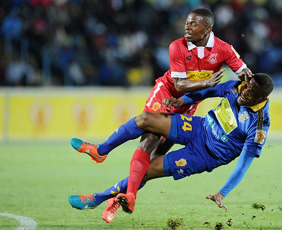 Tshepo Motlhabankwe of Township Rollers fouled by Gaopatwe Seosenyeng of Gaborone United during the 2015 Mascom Top 8 Final match between Township Rollers and Gaborone United at the National Stadium, Gaborone on the 18 April 2015  ©Muzi Ntombela/BackpagePix