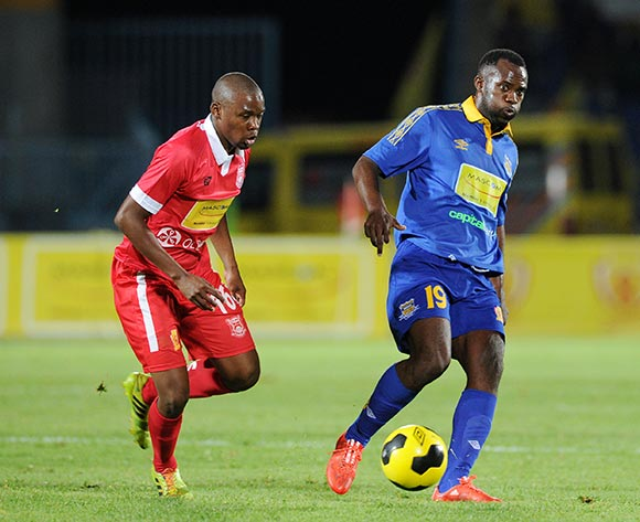 Jerome Louis of Township Rollers challenged by Thabiso Khunwene of Gaborone United during the 2015 Mascom Top 8 Final match between Township Rollers and Gaborone United at the National Stadium, Gaborone on the 18 April 2015  ©Muzi Ntombela/BackpagePix