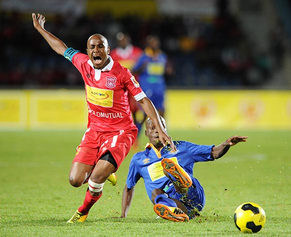 Edwin Olerile of Gaborone United tackled by Obonye Moswate of Township Rollers during the 2015 Mascom Top 8 Final match between Township Rollers and Gaborone United at the National Stadium, Gaborone on the 18 April 2015  ©Muzi Ntombela/BackpagePix