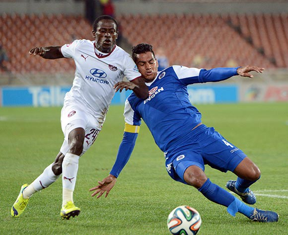 Clayton Daniels of Supersport United clears the ball ahead of Felix Obada of Moroka Swallows  during the Absa Premiership match between Supersport United and Moroka Swallows  on 18 April 2015 at Peter Mokaba Stadium Pic Sydney Mahlangu/BackpagePix