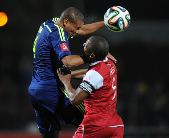 Dominic Isaacs of Ajax Cape Town clears the ball ahead of Paulus Masehe of Free Stae Stars during the Absa Premiership match between Free State Stars and Ajax Cape Town  on 21 April 2015 at Goble Park