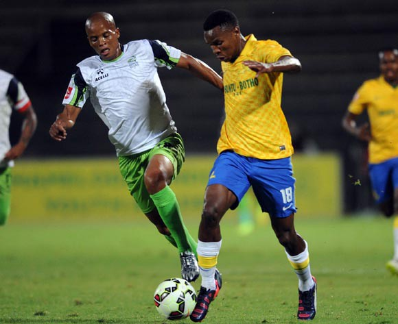 Themba Zwane of Mamelodi Sundowns is challenged by Solomon Mathe of Platinum Stars during the Absa Premiership match between Mamelodi Sundowns and Platinum Stars  on 22 April 2015 at Lucas Moripe Stadium