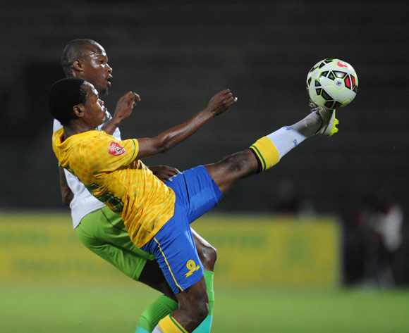 Percy Tau of Mamelodi Sundowns is challenged by Letladi Madubanya of Platinum Stars during the Absa Premiership match between Mamelodi Sundowns and Platinum Stars  on 22 April 2015 at Lucas Moripe Stadium