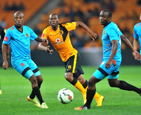 Reneilwe Letsholonyane of Kaizer Chiefs challenged by Jabulani Nene of Polokwane City during the Absa Premiership 2014/15 match between Kaizer Chiefs and Polokwane City at the FNB Stadium in Johannesburg, South Africa on April 22, 2015