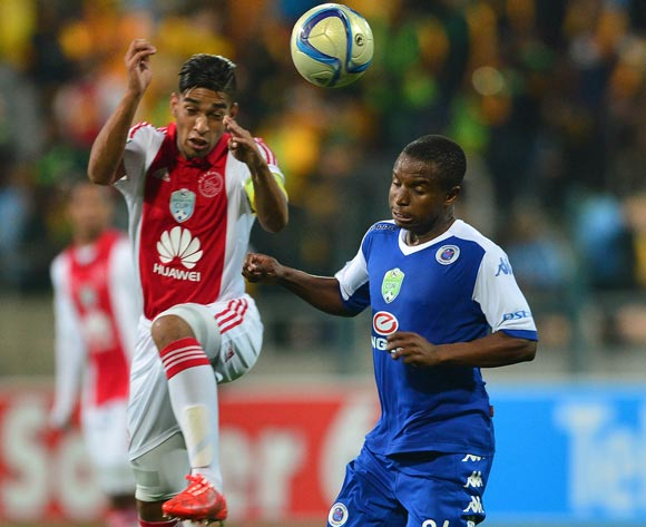 Travis Graham of Ajax Cape Town battles for the ball with David Mathebula of Supersport United during the Nedbank Cup, Semi Final Football Match between Ajax Cape Town and SuperSport United at Athlone Stadium, Cape Town on 25 April 2015