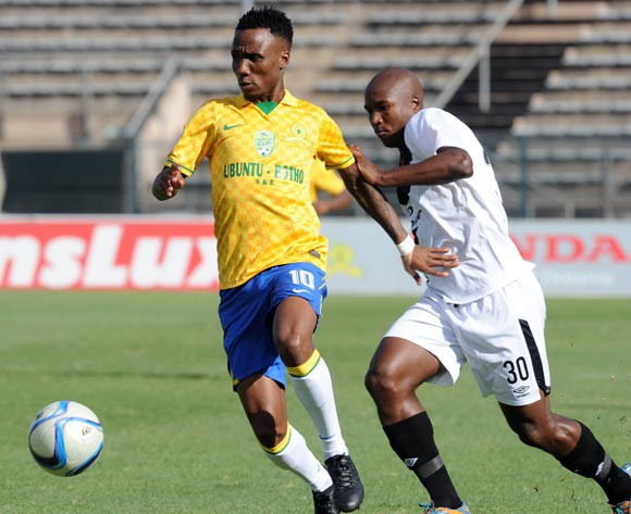 Teko Modise of Mamelodu Sundowns is challenged by Sibusiso Mxoyana of Vasco Da Gama during the Nedbank Cup Semi Final match between Mamelodi Sundowns and Vasco Da Gama  on 26 April 2015 at Lucas Moripe Stadium