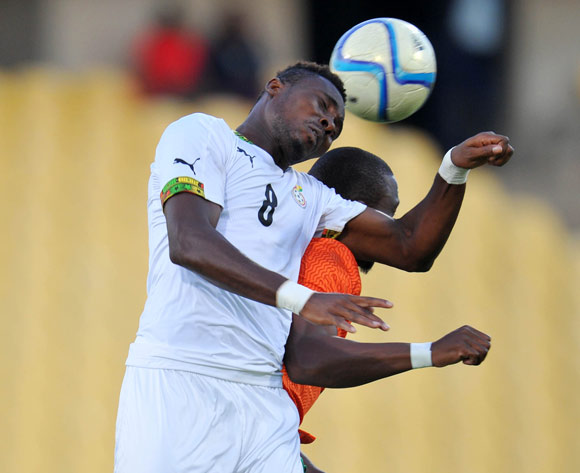 Alfred Nelson of Ghana battles with Bornwell Mwape of Zambia during the 2015 Cosafa Cup Plate Semi Finals match between Zambia and Ghana at Royal Bafokeng Stadium, Rustenburg on the 27 May 2015