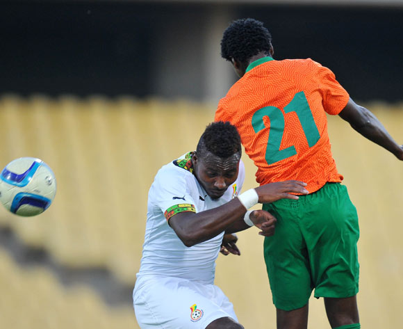 Jackson Mwanza of Zambia battles with Yakubu Mohammed of Ghana during the 2015 Cosafa Cup Plate Semi Finals match between Zambia and Ghana at Royal Bafokeng Stadium, Rustenburg on the 27 May 2015