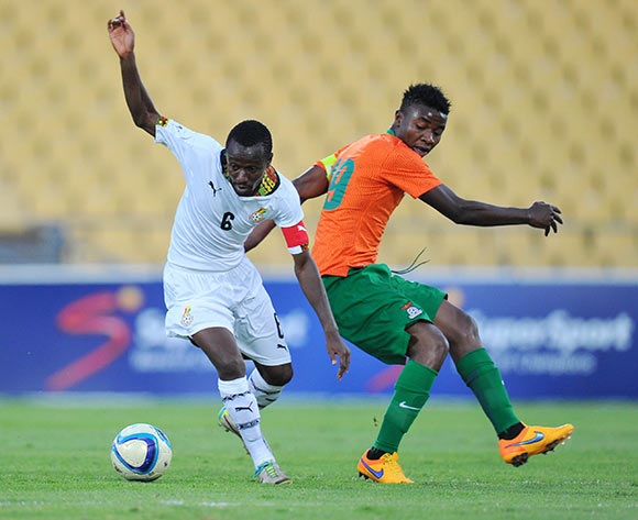 Michael Akuffu of Ghana challenged by Nathan Sinkala of Zambia during the 2015 Cosafa Cup Plate Semi Finals match between Zambia and Ghana at Royal Bafokeng Stadium, Rustenburg on the 27 May 2015  ©Muzi Ntombela/BackpagePix