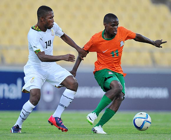 Allan Mukuka of Zambia challenged by Joshua Tijani of Ghana during the 2015 Cosafa Cup Plate Semi Finals match between Zambia and Ghana at Royal Bafokeng Stadium, Rustenburg on the 27 May 2015  ©Muzi Ntombela/BackpagePix